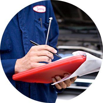 Mechanic performing automotive maintenance in Ottawa West, ON